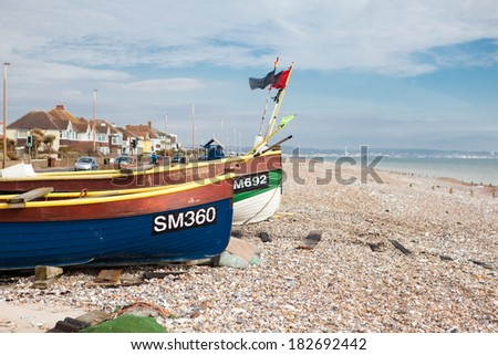 SOMPTING, ENGLAND - MARCH 18. Fishing boats on the beach, in Sompting, West Sussex, England on March 18, 2014