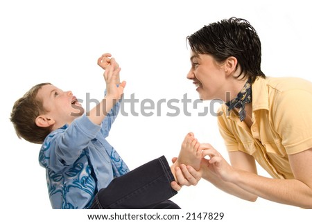 son being tickled by mom on white background