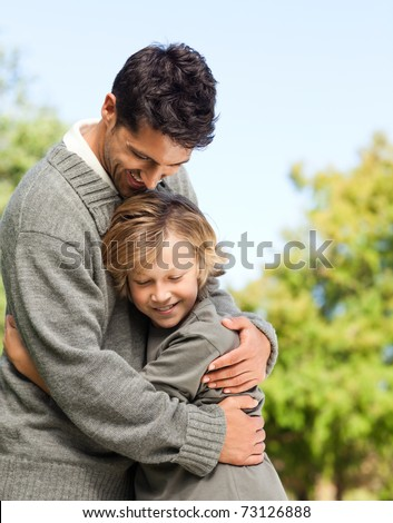Son embracing his father - stock photo