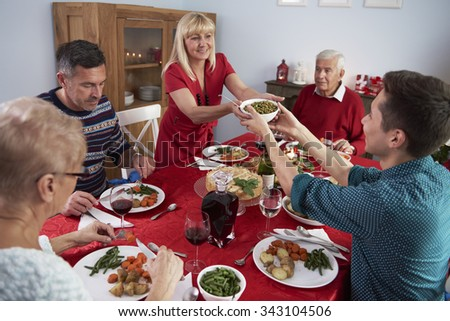 Son helping mother at the Christmas dinner