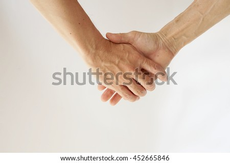 Son holding hand of his mom on the white background.