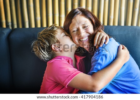 Son Kissing Mother Hugging Family Concept - stock photo