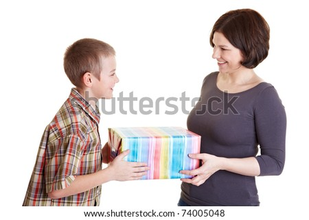 Son offering his mother a big gift - stock photo
