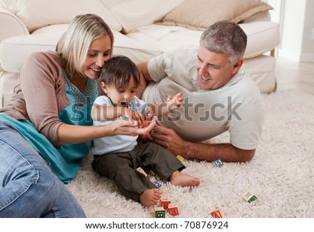 Son playing with his parents at home