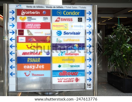 SON SANT JOAN, MAJORCA, SPAIN  ON NOVEMBER 4 2013: Information board with some of the airlines selling tickets at the airport, on November 4 2013 in Palma airport, Majorca, Spain.