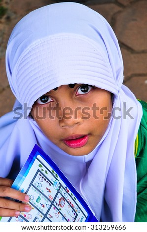 SONGKHLA, THAILAND - AUGUST 14 : Face of unidentified Children Asian Muslim girl in white hijab on August 14, 2015 in August, Songkhla Thailand. - stock photo