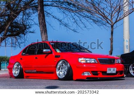 """SONGKHLA, THAILAND - March 09 : Red Tuned car in """"Songkhla Car Club Show 2014"""" at Samila beach on March 09,2014 in Songkhla, Thailand. - stock photo"""