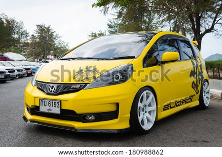 """SONGKHLA, THAILAND - March 09 : Tuned car Honda jazz in """"Songkhla Car Club Show 2014"""" at Samila beach on March 09,2014 in Songkhla, Thailand. - stock photo"""