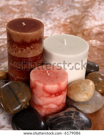 soothing scene of candles and rocks - stock photo