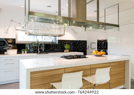 Sophisticated kitchen with a large kitchen worktop and kitchen island