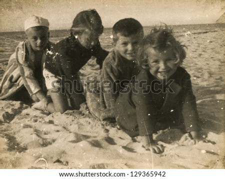 SOPOT, POLAND - CIRCA 1949: vintage photo of group of unidentified children playing on beach, circa 1949 in Sopot, Poland