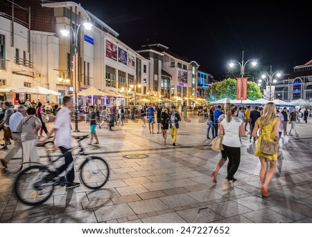 SOPOT, POLAND - JULY 18: Sopot, Poland - 18th July 2014: People walks on Heroes of Monte Cassino, most famous street on July 18, 2014 in Sopot - stock photo