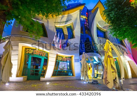SOPOT, POLAND - JUNE 6, 2016: The Crooked house on the Heroes of Monte Cassino street in Sopot, Poland. The Crooked House is an irregularly-shaped, one of fifty strangest buildings of the world. - stock photo