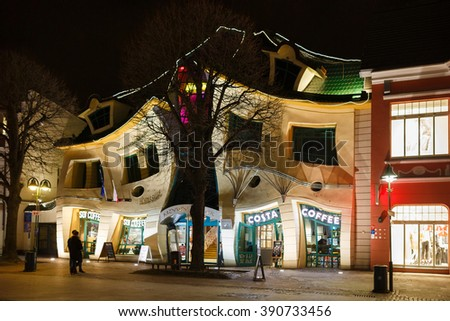 Sopot, Poland - March 07 2016: Night view of the Crooked House on the pedestrian street of Monte Cassino