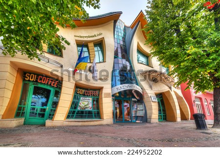 SOPOT, POLAND - 4 OCTOBER 2014: The Crooked house on the Heroes of Monte Cassino street in Sopot, Poland. The Crooked House is an irregularly-shaped, one of fifty strangest buildings of the world. - stock photo