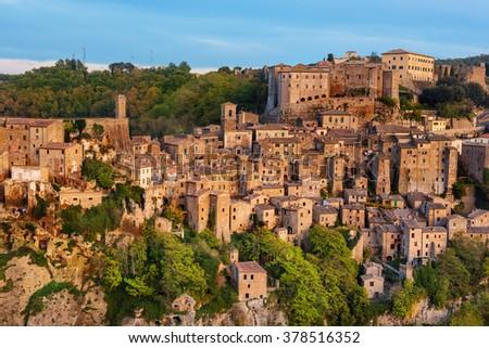 Sorano - tuff city in Tuscany. Italy. View in the dusk, travel background - stock photo