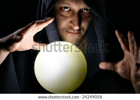 Sorcerer with glowing magical sphere close-up - stock photo