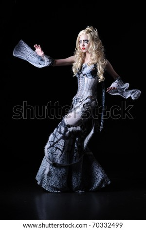 sorcerer with stage make-up in unusual dress, isolated on white - stock photo