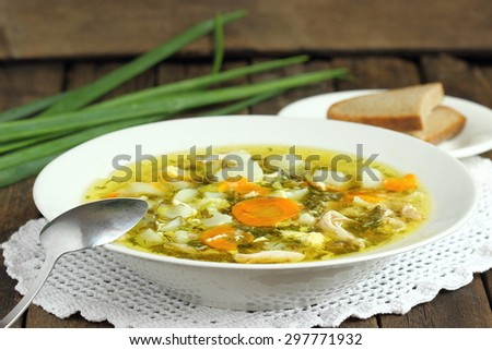 Sorrel soup with egg and greens in a plate - stock photo