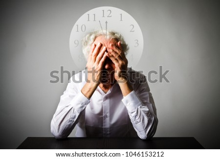Sorrow. Old man in white is waiting. Three Minutes to Twelve. Time is passing.