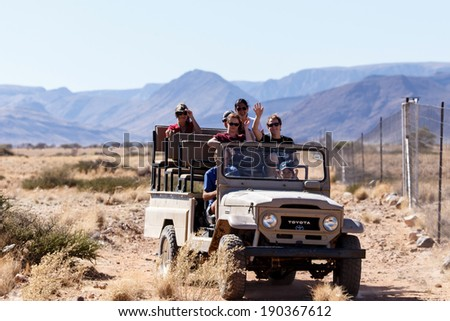 SOSSUSVLEI, NAMIBIA - NOVEMBER 2 2013: Tourists continue through the Namib Desert National Park in a year that was declared as a drought year by the government in Namibia, Africa - stock photo