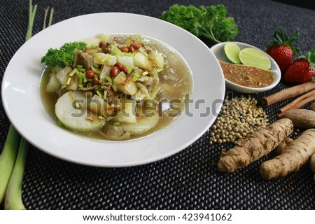 Soto Sabrang. Soto is a traditional Indonesian soup, Composed of broth, meat & vegetables. Soto Sabrang originally from Madura - East Java. Sabrang means Singkong in Bahasa, and Cassava in English.  - stock photo