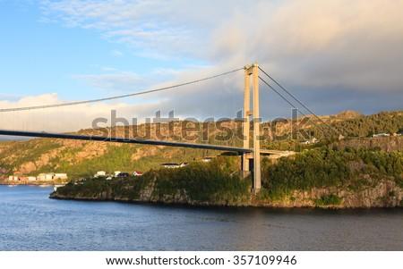Sotra Bridge.  Sotra bridge is a suspension bridge crossing Knarreviksundet in Norway connecting Fjell and Bergen. - stock photo