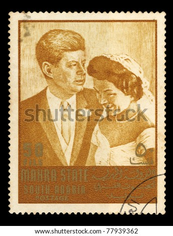 SOUDI ARABIA - CIRCA 1967: A stamp printed in Mahra State of Saudi Arabia shows wedding couple, circa 1967 - stock photo