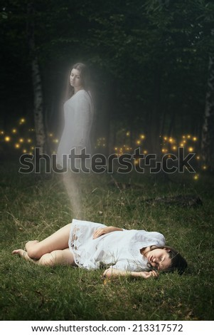 Soul of a dead girl is leaving her body. Forest spirits are waiting  - stock photo