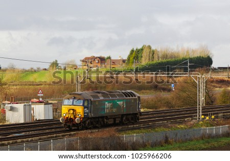 SOULBURY, UK - APRIL 28: 2015 A DRS operated class 57 diesel loco heads back to its depot in Norwich having dropped off coaches for refurbishment at the carriage works on April 28, 2015 in Soulbury