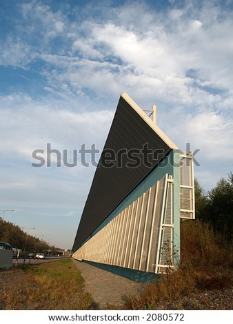 Sound and noise insulation wall near motorway at sunset, view - stock photo
