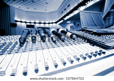 sound board and microphones in the concert hall. - stock photo