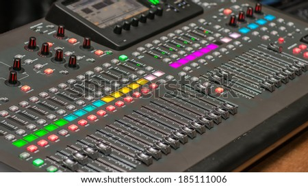 Sound console detail. DJ and audio operator equipment to produce a musical production - stock photo