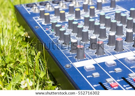 Sound Mixer, close-up shot on grass