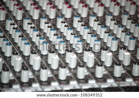 Sound mixer console in a recording studio - stock photo