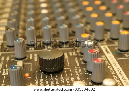 Sound mixer control. Selective focus on volume buttons. - stock photo
