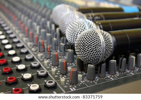 Sound mixing board during a musical performance at a fair - stock photo