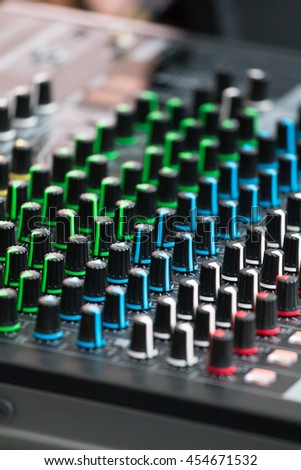 Sound music mixer control panel focusing on knobs control.