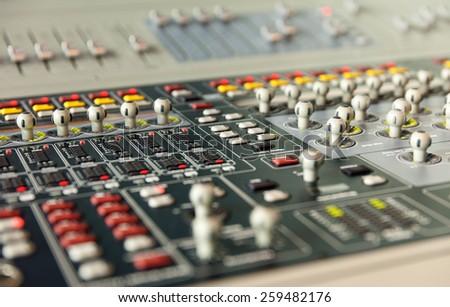 sound studio adjusting record equipment console sound engineer - stock photo