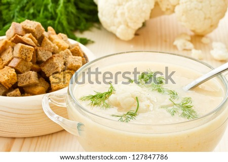 soup cauliflower puree and dill in a bowl