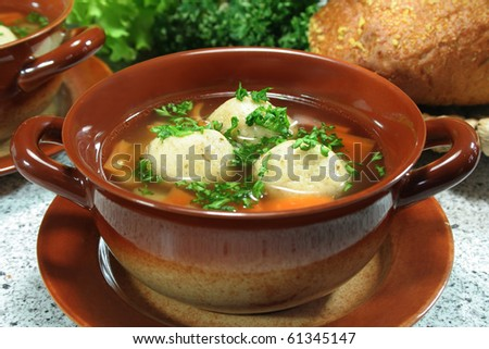 soup clear with bone marrow dumplings and parsley