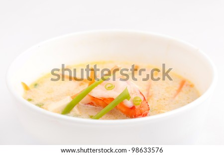Soup made from coconut milk and shrimps - stock photo