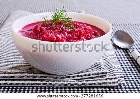 Soup of pureed red beets in a ceramic plate