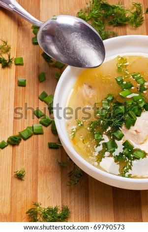 Soup plate on kitchen wooden table - stock photo