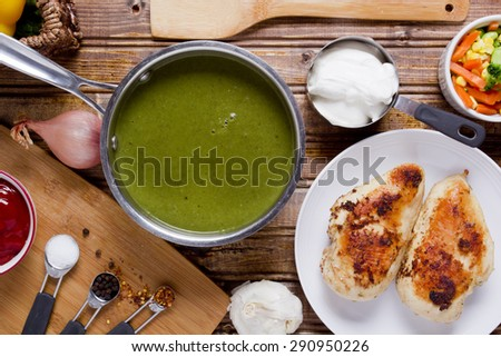Soup Puree spinach in the pan the chicken broth. - stock photo