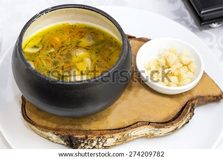 soup with beans and mushrooms garnished with goat cheese - stock photo