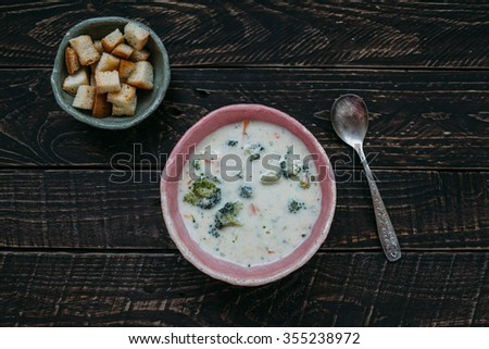 Soup with broccoli. ?heese soup, cream soup, soup with croutons, soup with broccoli, clay dishes - stock photo