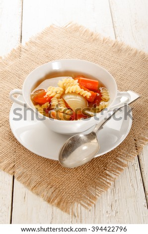 soup with carrot, onion and penne rigate in a bowl - stock photo