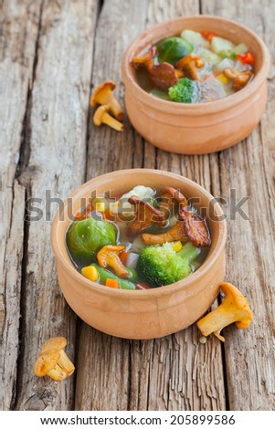 Soup with chanterelle and vegetables - corn, broccoli, carrots ...