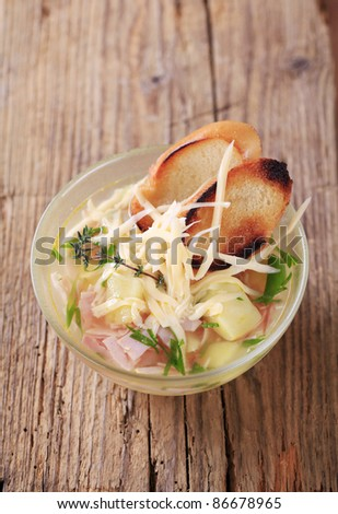Soup with cheese and ham  - stock photo